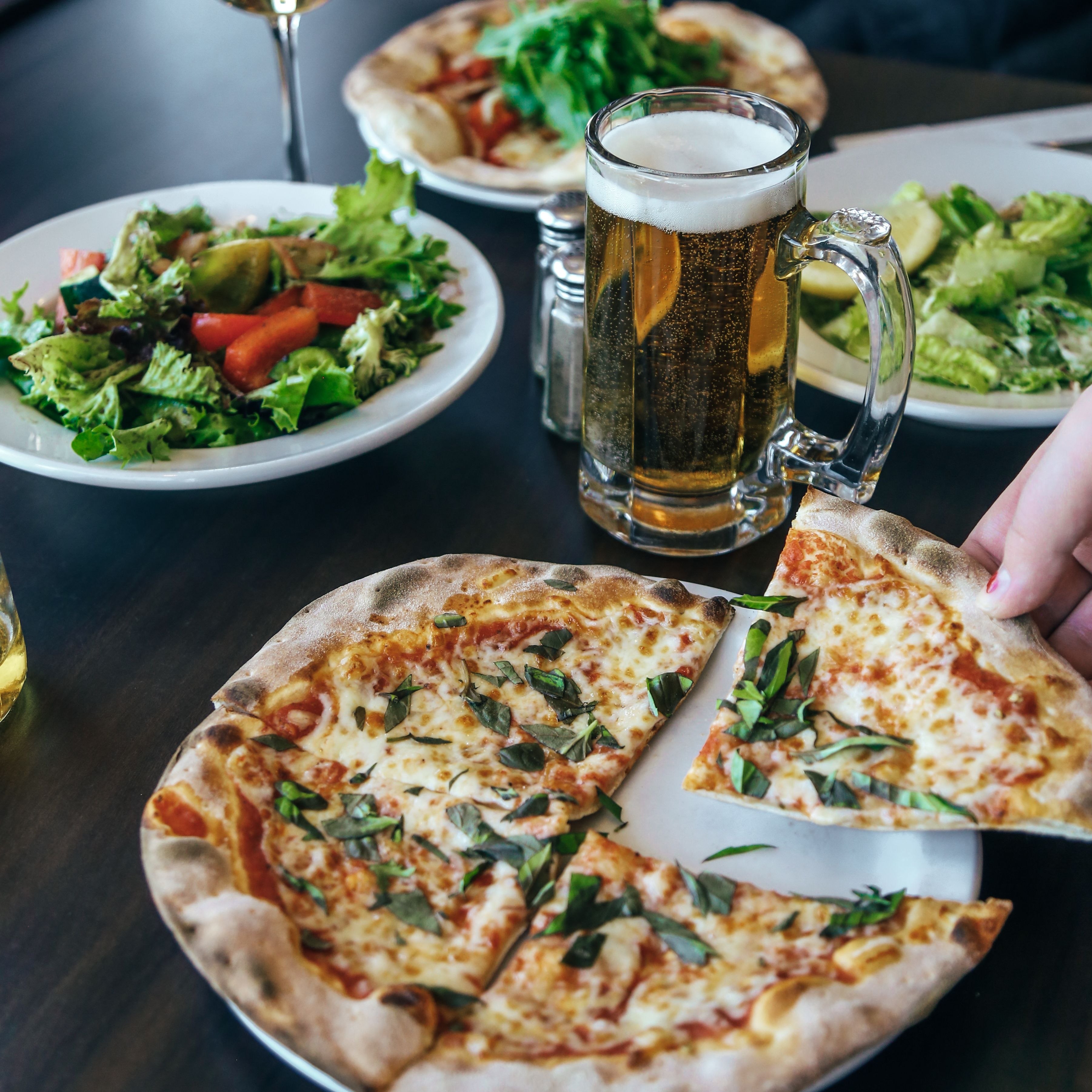 Pizza, salad and beer at La Piazza